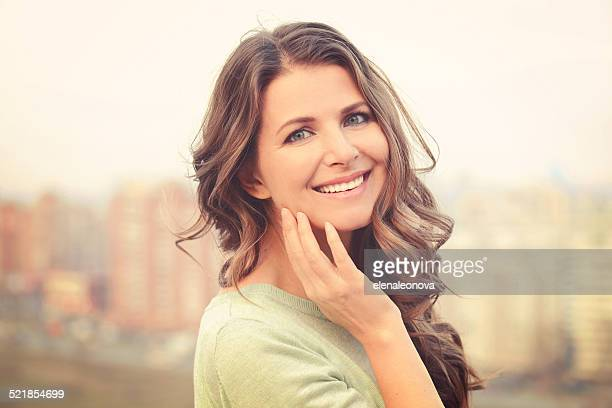 beautiful woman - mid adult women stock pictures, royalty-free photos & images