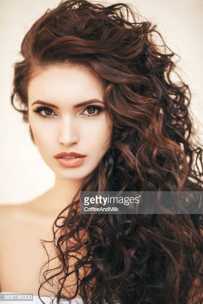 beautiful woman - curly hair stock pictures, royalty-free photos & images