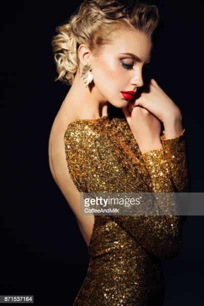 beautiful woman - gold dress stock pictures, royalty-free photos & images