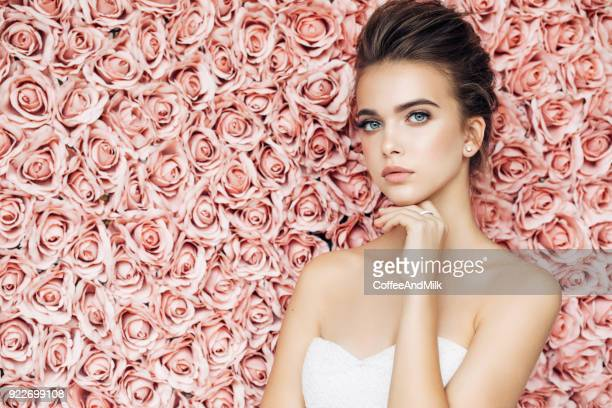 beautiful woman - pink dress stock photos and pictures