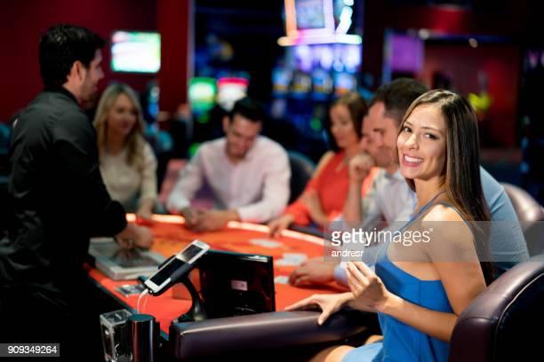 beautiful woman playing cards at the casino - green bay wisconsin imagens e fotografias de stock