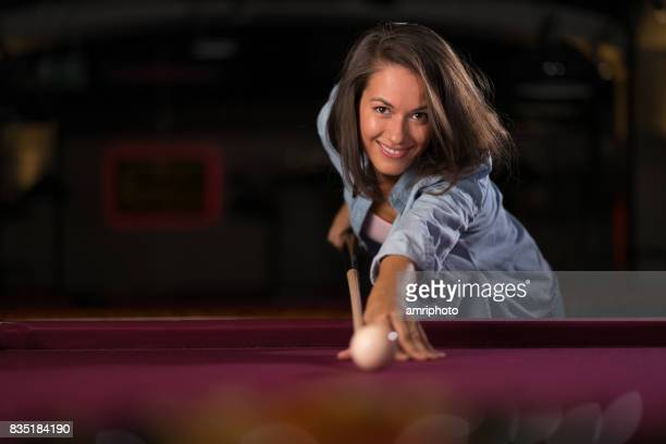 beautiful woman playing pool