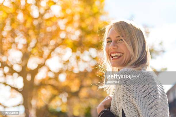 beautiful woman portrait on the street - sunlight stock pictures, royalty-free photos & images
