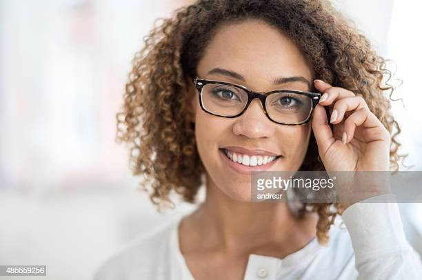beautiful woman portrait wearing glasses - optometry stock pictures, royalty-free photos & images