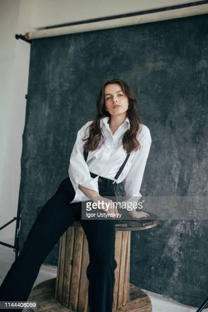 beautiful woman posing in studio - サスペンダー ストックフォトと画像