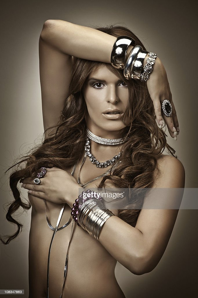 Naked Woman Wearing Jewelry Stock Photo | Getty Images