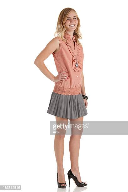 beautiful woman posing - women wearing short skirts stock pictures, royalty-free photos & images