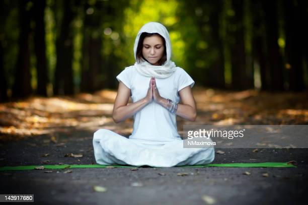 beautiful woman practicing yoga - chanting stock pictures, royalty-free photos & images
