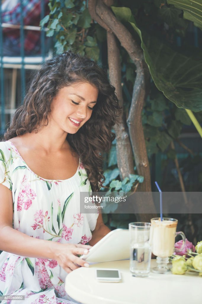 Beautiful woman reading in vintage cafe : Stock Photo