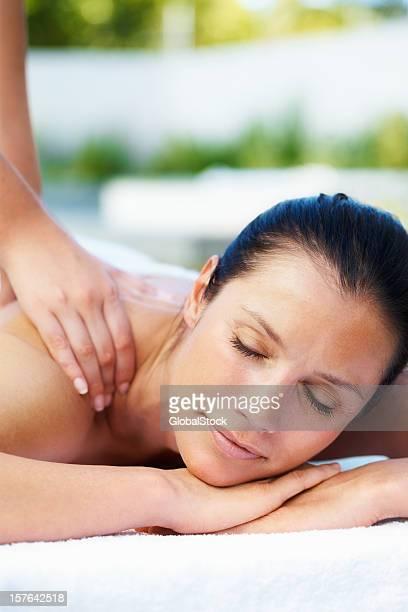 Beautiful woman receiving a shoulder massage