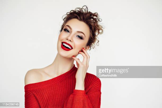 beautiful woman. red sweater and red lipstick. - red shirt stock pictures, royalty-free photos & images