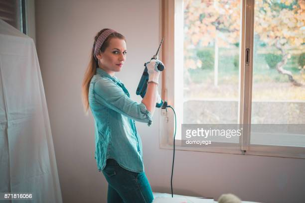 Beautiful woman redecorating home