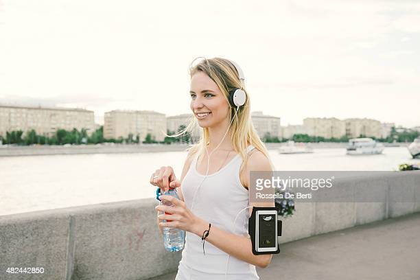 Beautiful Woman Relaxing After Workout Drinking Water