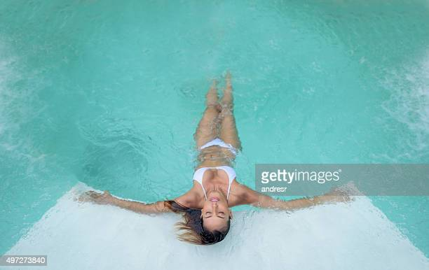 Beautiful woman relaxing at the swimming pool