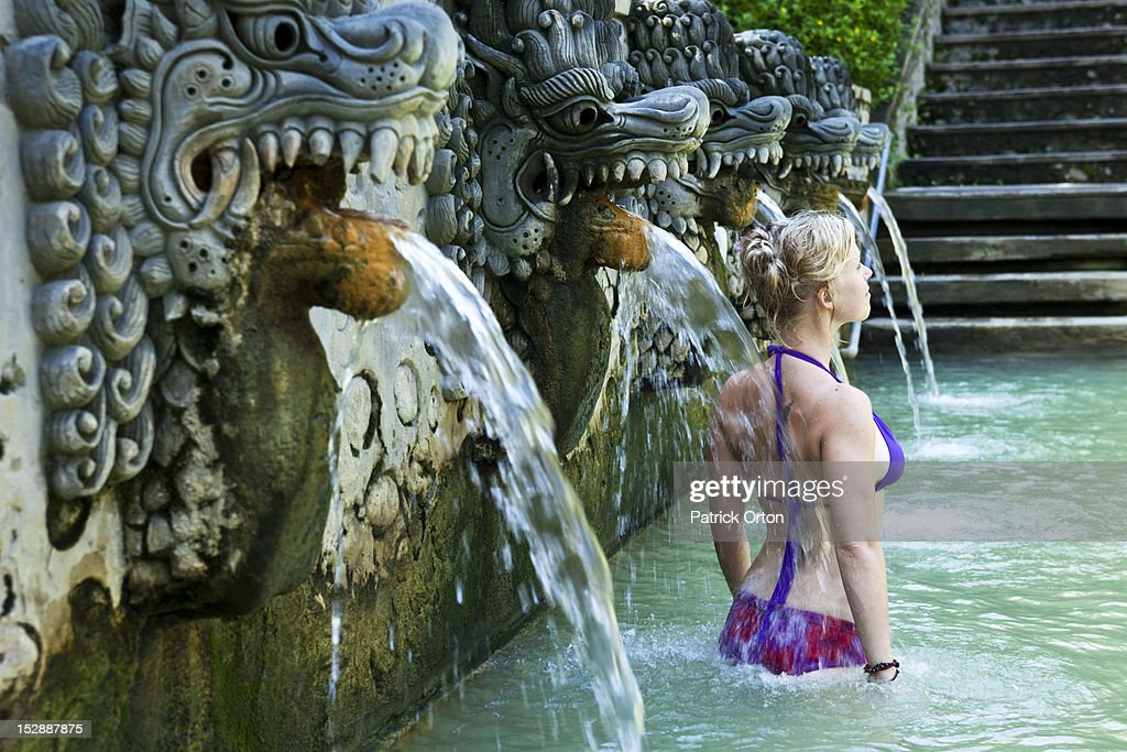 A Beautiful Woman Relaxing In A Hot Springs Surrounded By A