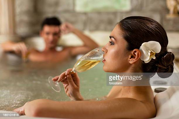 Beautiful woman relaxing in jacuzzi at health spa