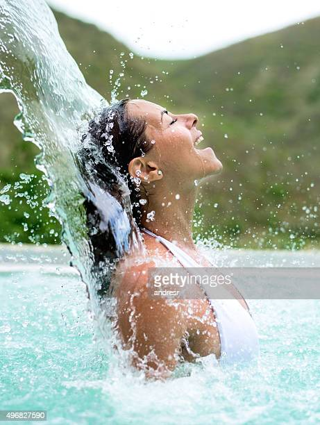 beautiful woman relaxing in the swimming pool - hydrotherapy stock photos and pictures