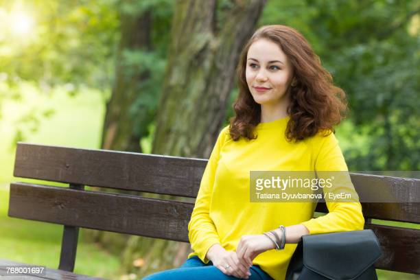 Beautiful Woman Relaxing On Bench At Park