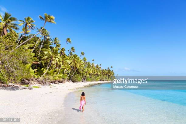 beautiful woman relaxing on sandy beach, fiji - fiji stock pictures, royalty-free photos & images