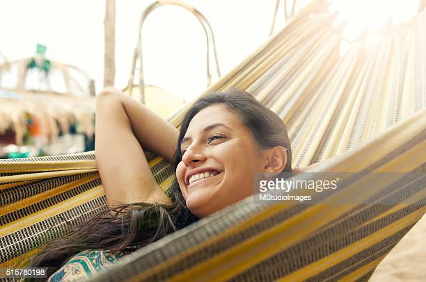 beautiful woman resting on hammock - native american stock photos and pictures