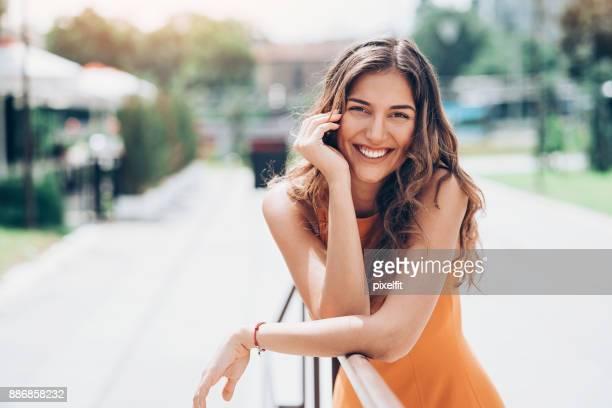 Beautiful woman resting outdoors at sunlight