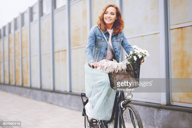 beautiful woman riding a bike. debica, poland - ankle length stock pictures, royalty-free photos & images