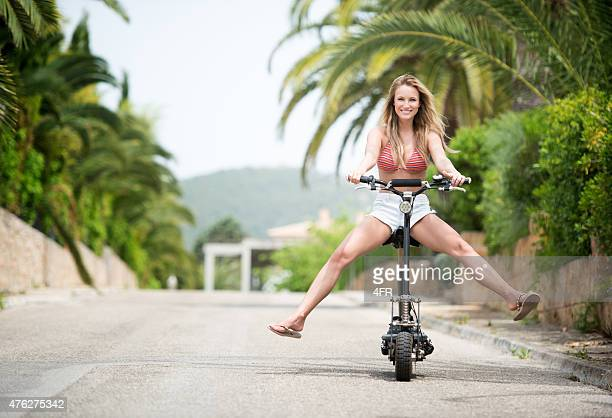 Beautiful woman riding an Electric Scooter