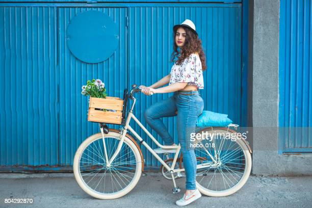 Beautiful woman riding her fancy bike