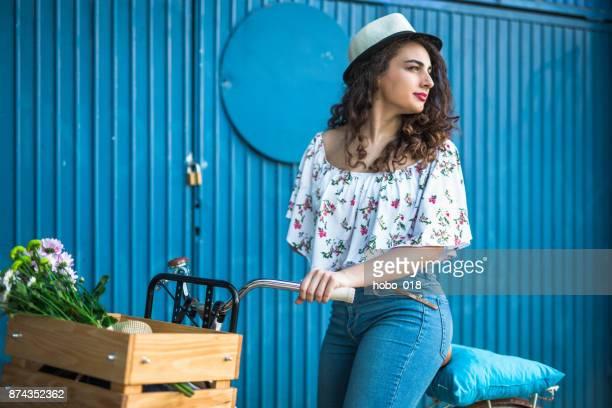 Beautiful woman riding her fancy bike