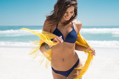 Beautiful woman running on beach 928866530