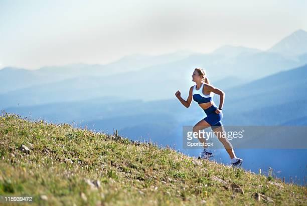 Beautiful Woman Running up Mountain
