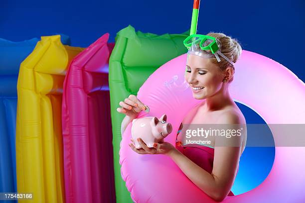 Beautiful woman saving for the holiday