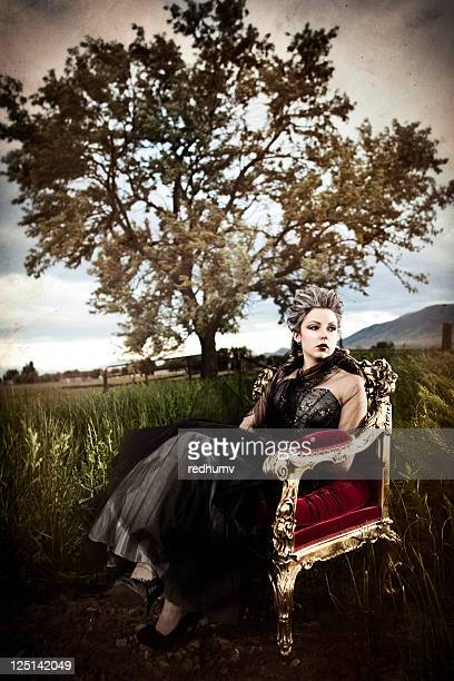 Beautiful Woman Seated in Throne and Tall Grass
