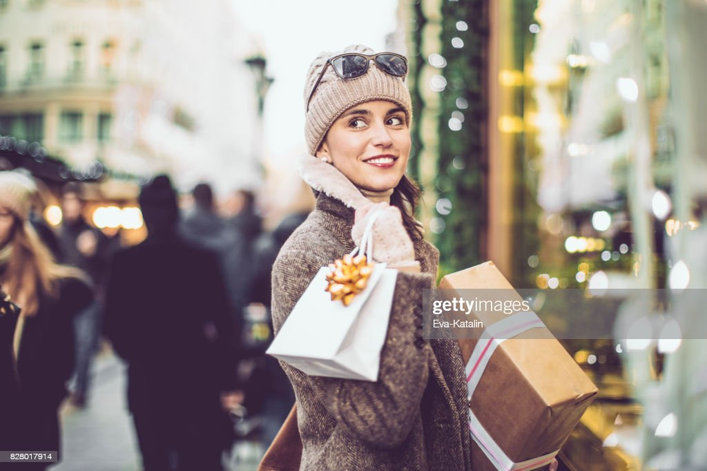 Beautiful woman shopping in the city : Stock Photo