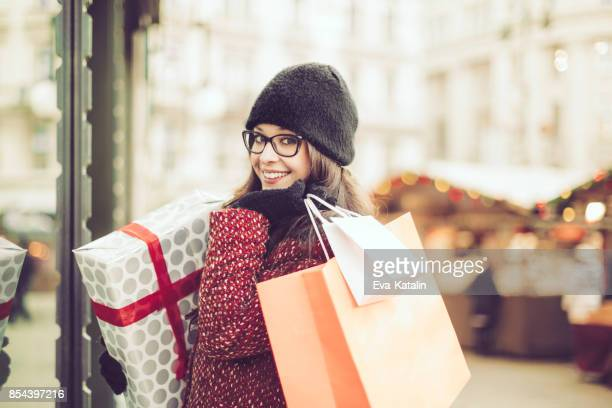beautiful woman shopping in the city - christmas shopping stock photos and pictures