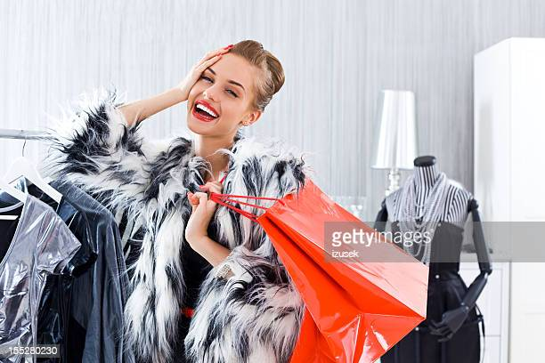 beautiful woman shopping - izusek stock pictures, royalty-free photos & images