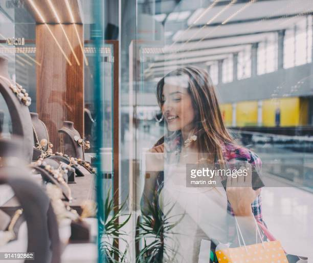 beautiful woman shopping - desire stock pictures, royalty-free photos & images