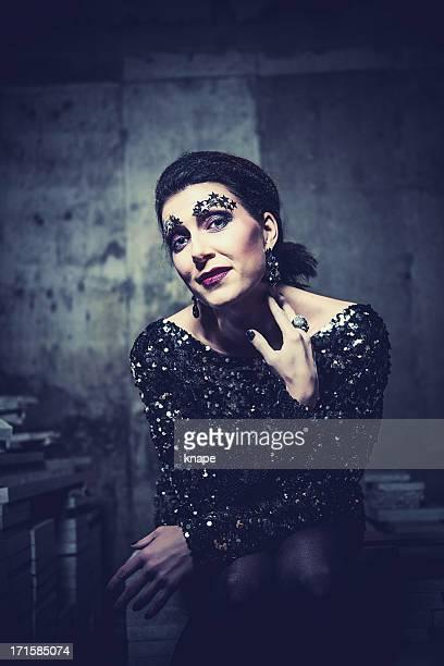 Beautiful woman sitting in a basement