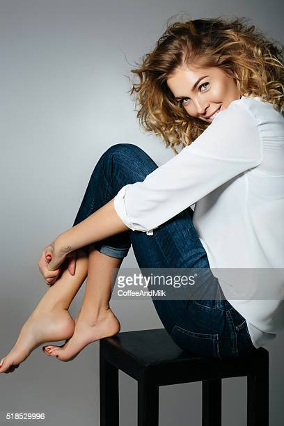 beautiful woman sitting on a chair - womans bare feet stock photos and pictures
