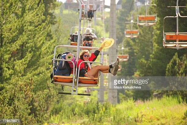 Beautiful woman sitting on chair lift smiling