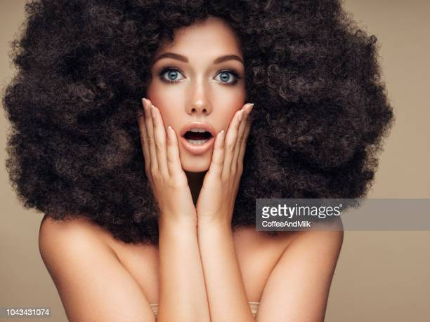 beautiful woman smiling - big hair stock photos and pictures