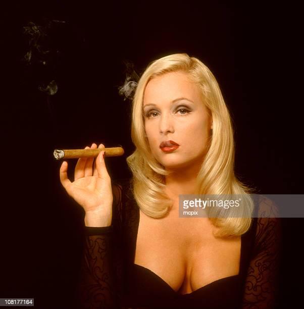 Beautiful woman smoking a cigar