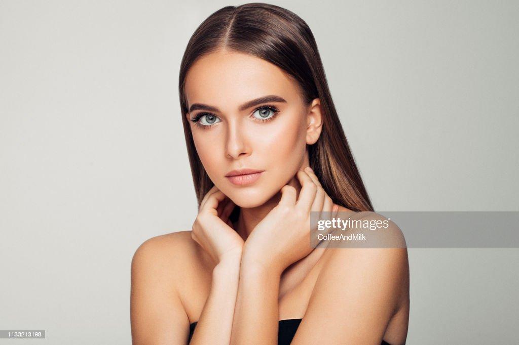 Beautiful woman. Soft make-up and perfect skin. : Stock Photo