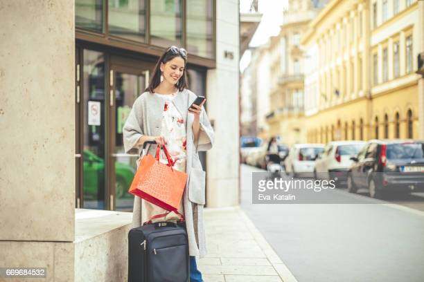 beautiful woman spending time in the city - global entry stock pictures, royalty-free photos & images