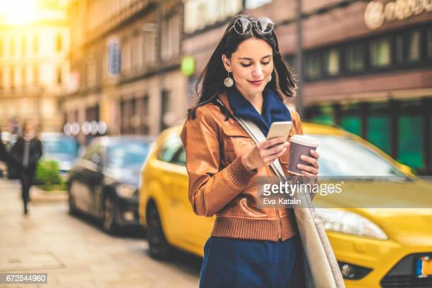 beautiful woman spending time in the city - city life stock pictures, royalty-free photos & images