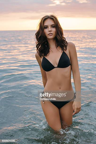 beautiful woman standing at the sea - seductive women stock pictures, royalty-free photos & images