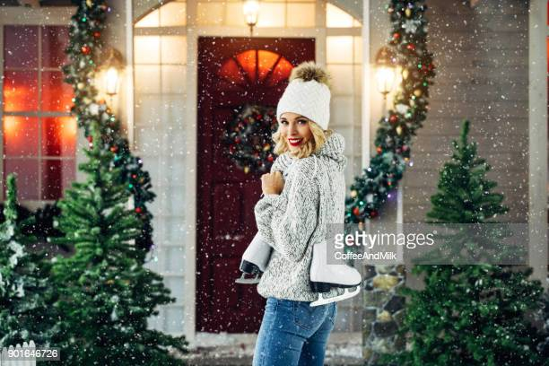 Beautiful woman standing in front of her house