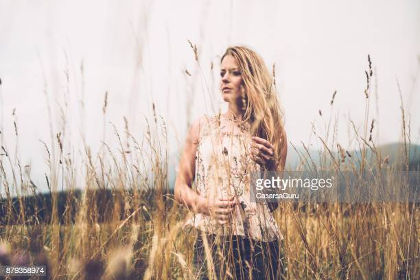 Beautiful Woman Standing on Grass Field