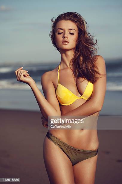 Beautiful woman standing on the beach