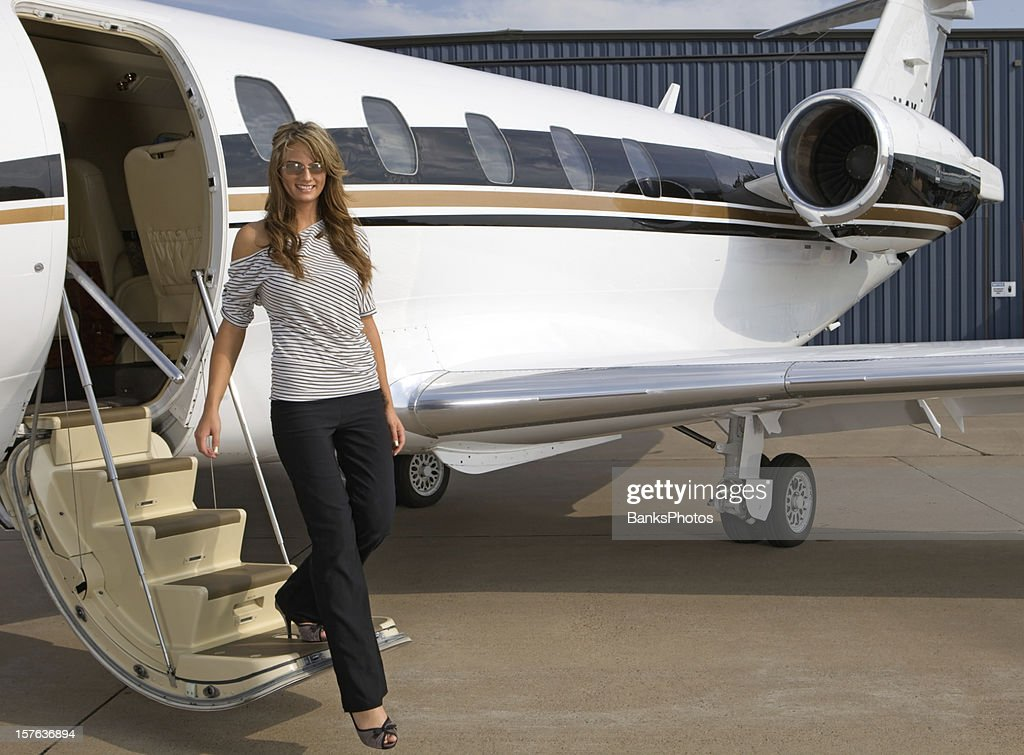 Beautiful Woman Steps off a Private Jet : Stock Photo